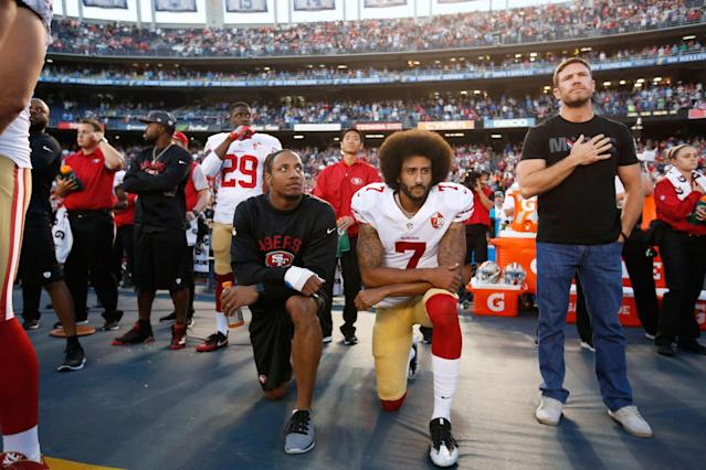 Eric Reid (L) and Colin Kaepernick of the San Francisco 49ers kneel during the national anthem on Sept. 1, 2016 (Getty/Michael Zagaris)