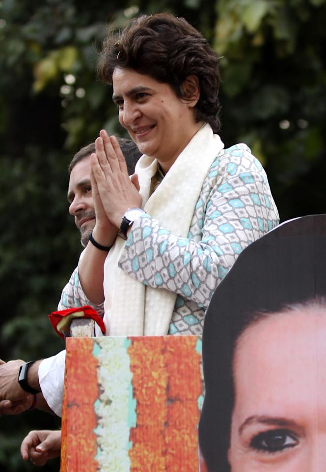 <p>Indian political scion Priyanka Gandhi Vadra (C) gestures at a rally with her brother Congress Party leader Rahul Gandhi in Lucknow, the capital of the election bellwether Uttar Pradesh state, on February 11, 2019. (Photo by STR / AFP) (Photo credit should read STR/AFP/Getty Images) </p>