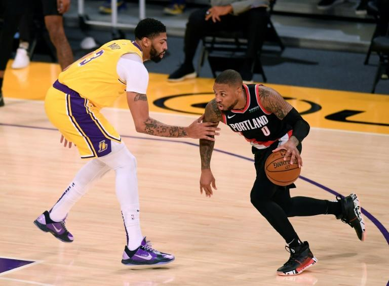 Portland's Damian Lillard drives to the basket against Anthony Davis in the Trail Blazers' 115-107 NBA win over the Los Angeles Lakers
