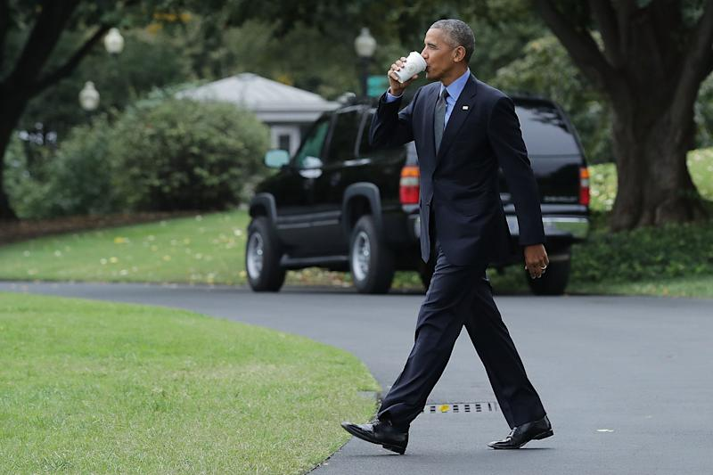 Barack Obama takes a sip of tea as he walks across the South Lawn in 2016. (Chip Somodevilla via Getty Images)