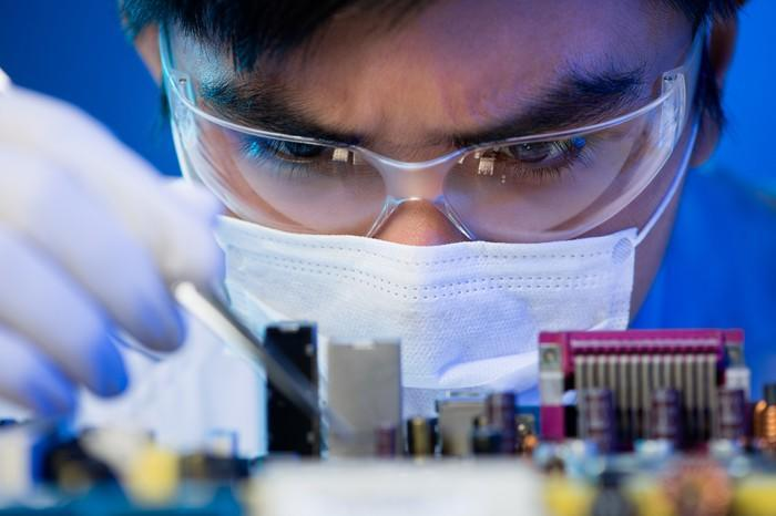 An engineer at work on a microchip.