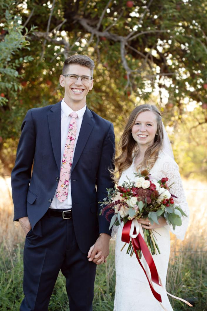 Ryan and Rachel May are shown at their September 2018 wedding. Ryan, then 21, started experiencing ALS symptoms on his honeymoon. He's now using a feeding tube.
