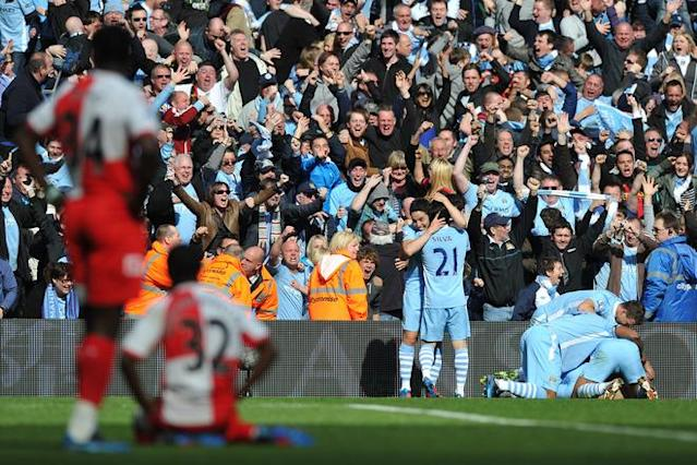 Manchester City's Argentinian striker Sergio Aguero (R) celebrates his late winning goal with team-mates during the English Premier League football match between Manchester City and Queens Park Rangers at The Etihad stadium in Manchester, north-west England on May 13, 2012. Manchester City won the game 3-2 to secure their first title since 1968. AFP PHOTO/PAUL ELLIS RESTRICTED TO EDITORIAL USE. No use with unauthorized audio, video, data, fixture lists, club/league logos or 'live' services. Online in-match use limited to 45 images, no video emulation. No use in betting, games or single club/league/player publications.PAUL ELLIS/AFP/GettyImages