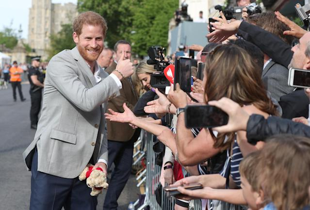 Prince Harry meets members of the public outside Windsor Castle on May 18, 2018, ahead of his wedding to Meghan Markle this weekend. (Photo: Jonathan Brady/pool via Reuters)