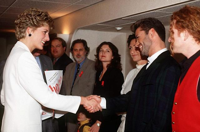 "Princess Diana met George Michael, K.D. Lang, and Mick Hucknall at the World Aids Day Annual ""Concert of Hope"" in 1993. (Photo: Tim Graham/Getty Images)"