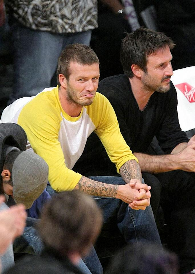 """David Beckham shoots the paparazzi a pout as he and David Arquette watch the highly-anticipated game from their pricey courtside seats. Noel Vasquez/<a href=""""http://www.gettyimages.com/"""" target=""""new"""">GettyImages.com</a> - December 16, 2008"""