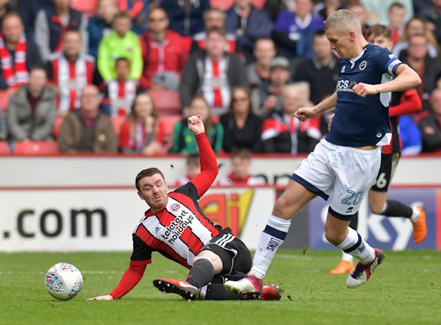 "Soccer Football - Championship - Sheffield United vs Millwall - Bramall Lane, Sheffield, Britain - April 14, 2018 Sheffield United's John Fleck in action with Millwall's Steve Morison Action Images/Paul Burrows EDITORIAL USE ONLY. No use with unauthorized audio, video, data, fixture lists, club/league logos or ""live"" services. Online in-match use limited to 75 images, no video emulation. No use in betting, games or single club/league/player publications. Please contact your account representative for further details."