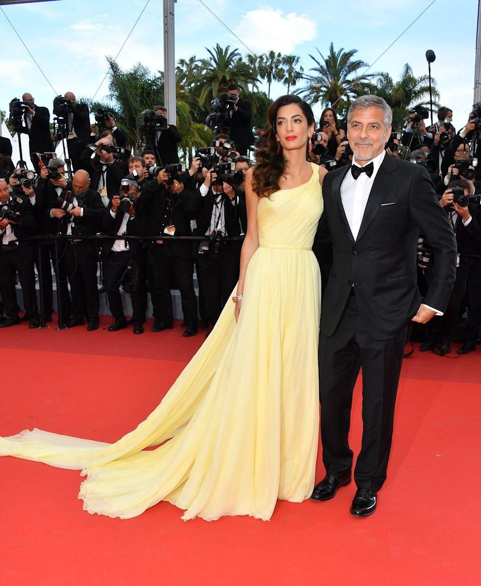 <p>Human rights lawyer Amal Clooney made her radiant Cannes Film Festival debut wearing a light yellow silk chiffon Atelier Versace gown on the arm of her husband George. From that moment on we knew we had a new favourite red-carpet star to watch. </p>