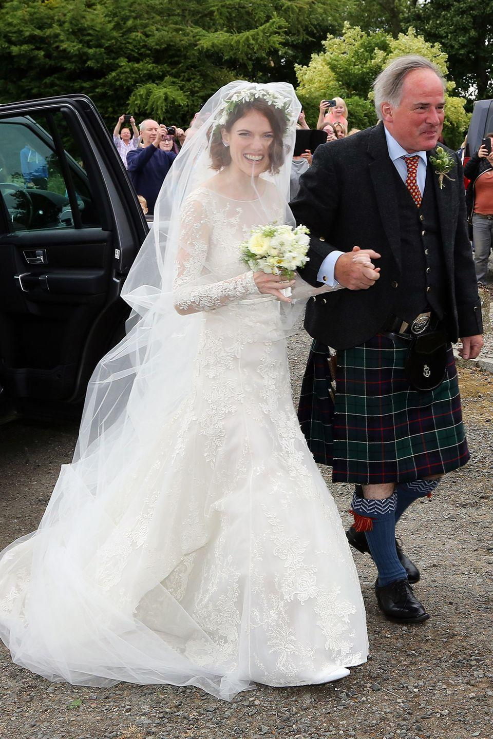 <p>Rose wore a stunning vintage-style Elie Saab wedding dress to wed <em>Game of Thrones</em> co-star Kit Harington in Scotland. The North will certainly remember this gorgeous look!</p>