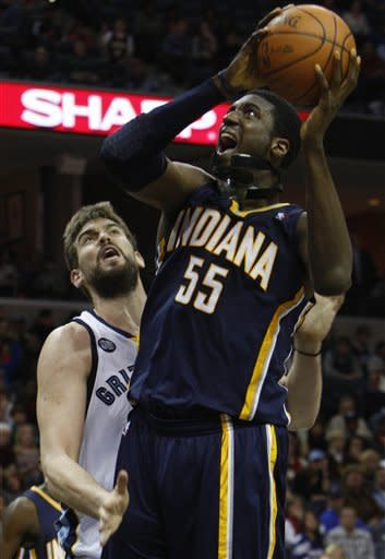 Memphis Grizzlies center Marc Gasol (33) defends Indiana Pacers center Roy Hibbert (55) in the second half of an NBA basketball game on Friday, Feb. 10, 2012, in Memphis, Tenn. The Grizzlies won 98-92. (AP Photo/Alan Spearman)