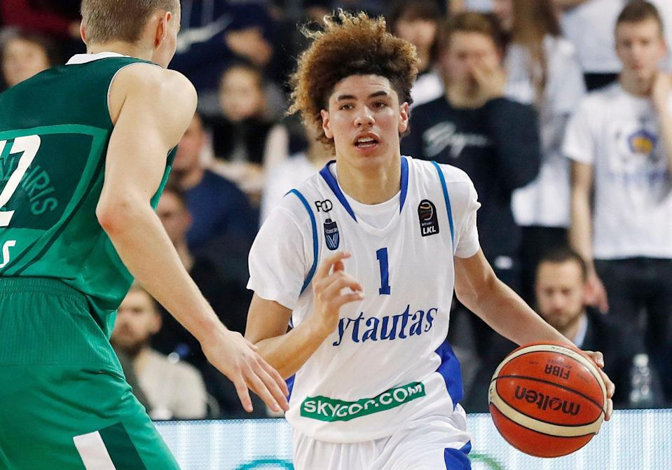 FILE - In this Jan. 9, 2018, file photo, BC Prienu Vytautas's LaMelo Ball is shown in action during the Big Baller Brand Challenge friendly tournament match against BC Zalgiris-2 in Prienai, Lithuania. LaMelo Ball, the brother of Los Angeles Lakers guard Lonzo Ball, has been ejected from a game in Lithuania after striking an opponent. Ball clashed with Lithuanian player Mindaugas Susinskas during Monday's, Oct. 1, 2018, exhibition game between local club Dzukija and a touring team of United States players from the Junior Basketball Association established by the Ball brothers' father, LaVar Ball. (AP Photo/Liusjenas Kulbis, File)