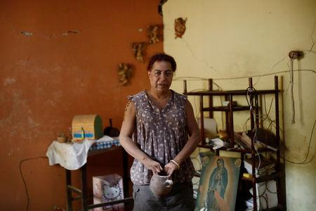 Felina, 50, an indigenous Zapotec transgender woman also know as Muxe, poses for a photo inside her house destroyed after an earthquake that struck on the southern coast of Mexico late on Thursday, in Juchitan, Mexico, September 10, 2017. Picture taken, September 10, 2017. REUTERS/Edgard Garrido