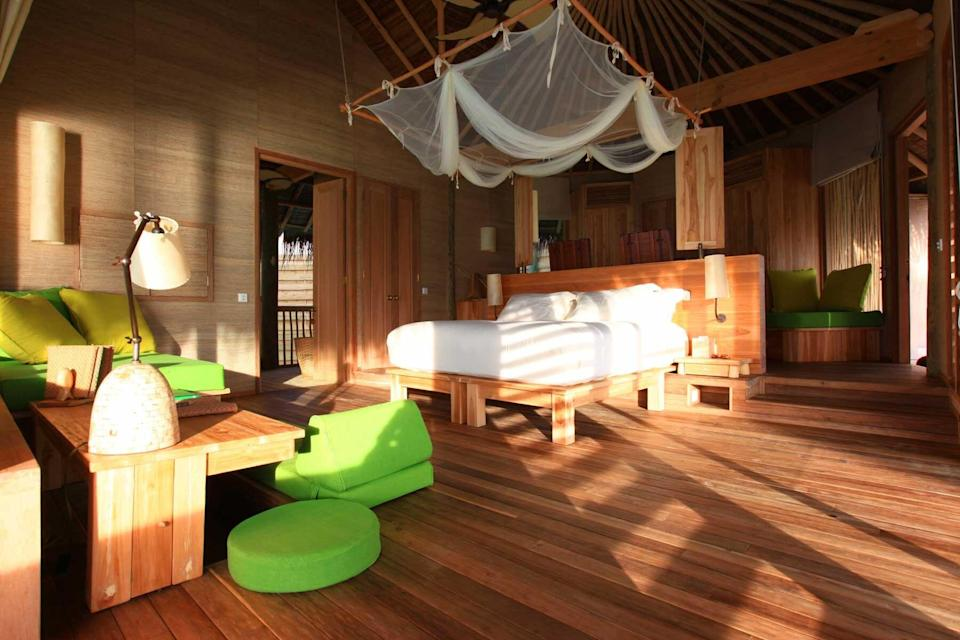 A light filled guest room at the Six Senses Laamu, voted one of the best hotels in the world