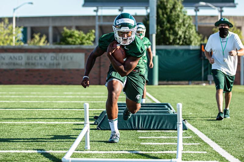 Michigan State running back Elijah Collins goes through drills during the Spartans' first practice of preseason camp Friday, Aug. 7, 2020, in East Lansing.