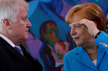 Merkel talks to Interior Minister Horst Seehofer in Berlin Germany