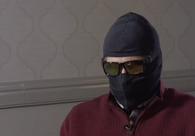 Grigory Rodchenkov covered his face with a mask and sunglasses for a television interview with the BBC. (Screenshot: BBC)