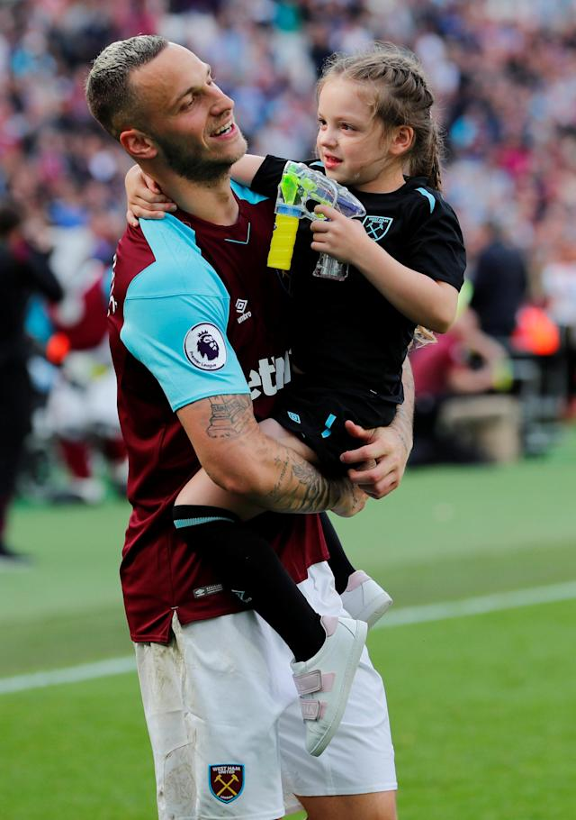 "Soccer Football - Premier League - West Ham United vs Everton - London Stadium, London, Britain - May 13, 2018 West Ham United's Marko Arnautovic with child during a lap of honour after the match REUTERS/Eddie Keogh EDITORIAL USE ONLY. No use with unauthorized audio, video, data, fixture lists, club/league logos or ""live"" services. Online in-match use limited to 75 images, no video emulation. No use in betting, games or single club/league/player publications. Please contact your account representative for further details."