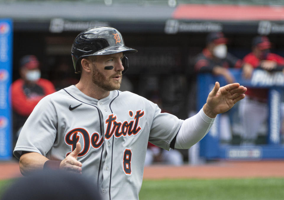 Detroit Tigers' Robbie Grossman celebrates after scoring on an RBI single by Jeimer Candelario during the first inning of a baseball game in Cleveland, Sunday, April 11, 2021. (AP Photo/Phil Long)
