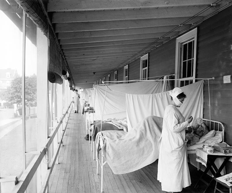 A nurse checking on a patient at the Walter Reed Hospital Flu Ward in Washington during the influenza pandemic of 1918. (Photo: Harris & Ewing/Underwood Archives/Getty Images)