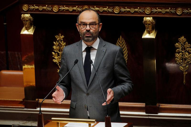 "French Prime Minister Edouard Philippe delivers a speech during a debate about a motion of confidence in the French government due to the ""yellow vests"" crisis by the left-wing members of parliaments at the National Assembly in Paris"