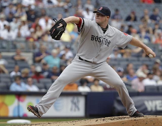Boston Red Sox starting pitcher Jon Lester throws during the first inning of the baseball game against the New York Yankees at Yankee Stadium, Sunday, Sept. 8, 2013, in New York. (AP Photo/Seth Wenig)