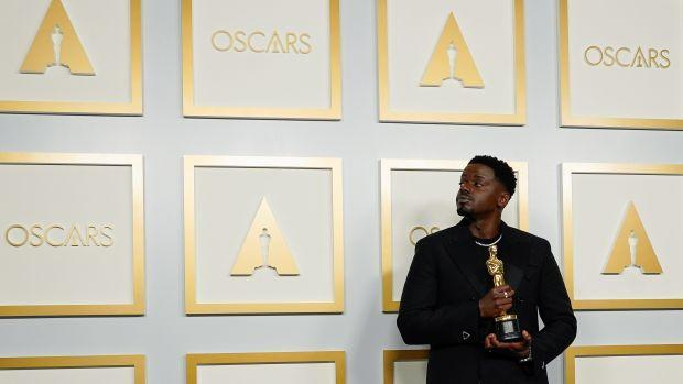 """Daniel Kaluuya, winner of the Award for Best Actor in a Supporting Role for """"Judas and the Black Messiah"""", poses at the press room of the Oscars, in the 93rd Academy Awards in Los Angeles, California, U.S., April 25, 2021."""