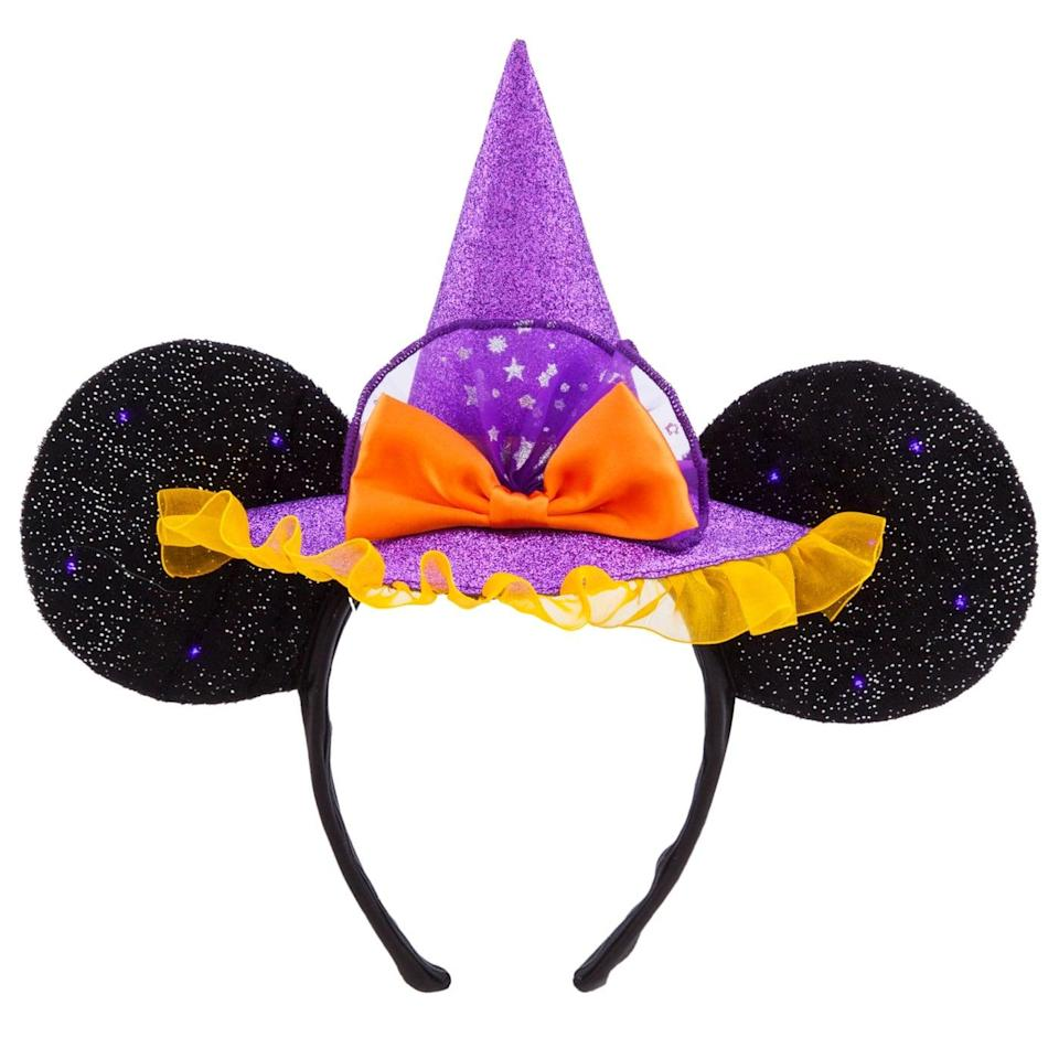 """<p>You can't go wrong with a pair of magical Minnie ears, and this <span>Minnie Mouse Witch Ear Headband</span> ($28) is bewitching. It's a cute way to add a dash of <a class=""""link rapid-noclick-resp"""" href=""""https://www.popsugar.com/Halloween"""" rel=""""nofollow noopener"""" target=""""_blank"""" data-ylk=""""slk:Halloween"""">Halloween</a> spirit to any outfit. </p>"""
