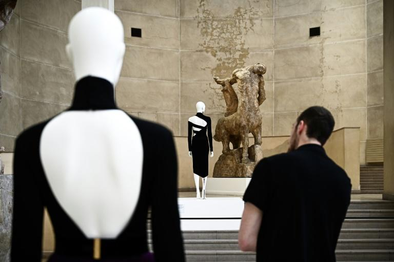The human back is always there yet almost never seen in fashion images, forgotten amid the focus on the front and faces (AFP Photo/Philippe LOPEZ)