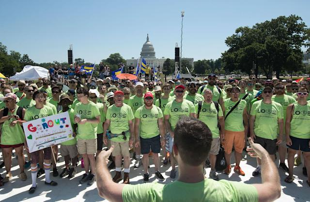 <p>GALA Chorus members from around the country sing on the National Mall with Capitol Hill in the background during the Equality March for Unity and Pride in Washington, Sunday, June 11, 2017. (Photo: Carolyn Kaster/AP) </p>