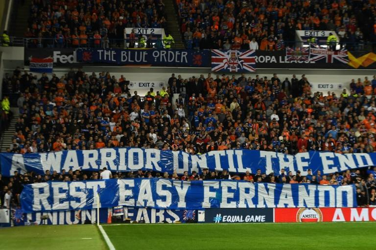 Rangers fans paid tribute to Fernando Ricksen, who died aged 43 on Wednesday after a lengthy illness (AFP Photo/ANDY BUCHANAN )
