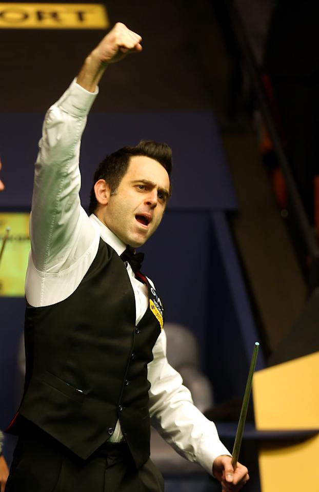 SHEFFIELD, ENGLAND - MAY 06:  Ronnie O'Sullivan of England celebrates beating Barry Hawkins of England to win the Betfair World Snooker Championship at the Crucible Theatre on May 6, 2013 in Sheffield, England.  (Photo by Warren Little/Getty Images)