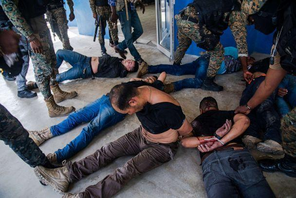 PHOTO: Police officers guard a group of alleged suspects in Port-au-Prince, Haiti, July 8,2021.  (Jean Marc Herve Abelard/EPA via Shutterstock)