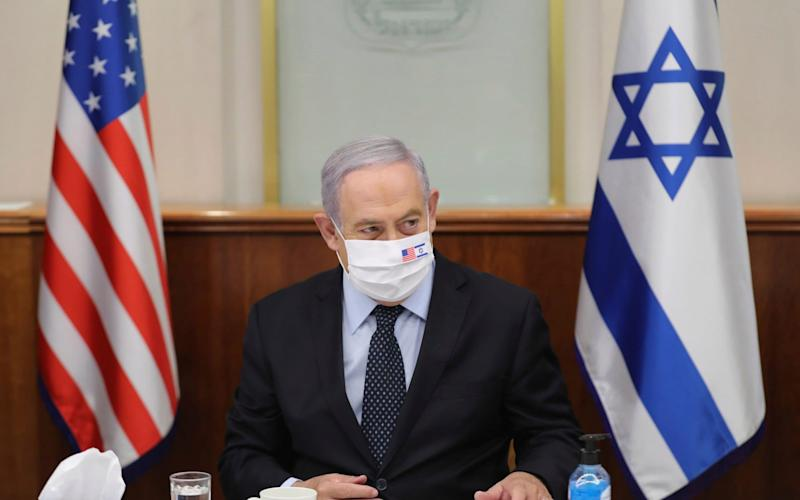 Israeli Prime Minister Benjamin Netanyahu attends a press briefing wearing a mask - POOL EPA
