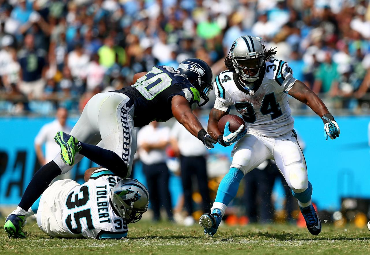 CHARLOTTE, NC - SEPTEMBER 08: DeAngelo Williams #34 of the Carolina Panthers runs with the ball against the Seattle Seahawks during their game at Bank of America Stadium on September 8, 2013 in Charlotte, North Carolina. (Photo by Streeter Lecka/Getty Images)