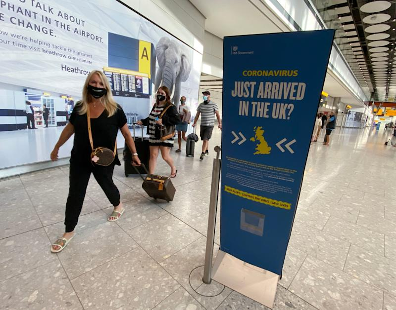 Passengers arrive at Heathrow Airport from the Greek island of Mykonos, hours before the 4am quarantine comes into force. (PA)