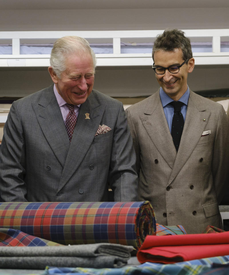 Prince Charles is pictured with Yoox Net-A-Porter chairman Federico Marchetti during a visit to Dumfries House in Ayrshire, Scotland. [Photo: Getty]