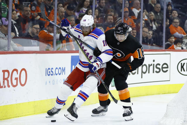 Philadelphia Flyers' Tyler Pitlick, right, and New York Rangers' Marc Staal battle for the puck during the second period of an NHL hockey game, Friday, Feb. 28, 2020, in Philadelphia. (AP Photo/Matt Slocum)
