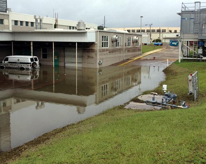 In this photo provided by the Escambia County Sheriffís Department, floodwater surrounds the Escambia County Jail, Sunday, June 10, 2012, in Escambia County, in Florida. More than 600 inmates at the jail were without power and air conditioning after the rains left more than 5-feet of water in the bottom floor, which also houses the laundry and kitchen facilities. (AP Photo/Escambia County Sheriff's Department)
