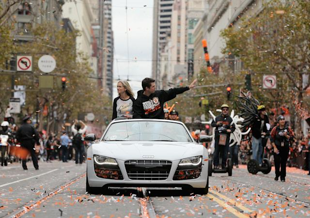 SAN FRANCISCO, CA - OCTOBER 31: Buster Posey #28 of the San Francisco Giants waves to the crowd during the San Francisco Giants World Series victory parade on October 31, 2012 in San Francisco, California. The San Francisco Giants beat the Detroit Tigers to win the 2012 World Series. (Photo by Ezra Shaw/Getty Images)