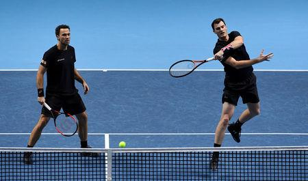 Tennis - ATP World Tour Finals - The O2 Arena, London, Britain - November 18, 2017   Britain's Jamie Murray and Brazil's Bruno Soares in action during their doubles semi final match against Finland's Henri Kontinen and Australia's John Peers     Action Images via Reuters/Tony O'Brien