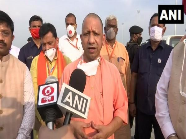 Uttar Pradesh Chief Minister Yogi Adityanath speaking to reporters