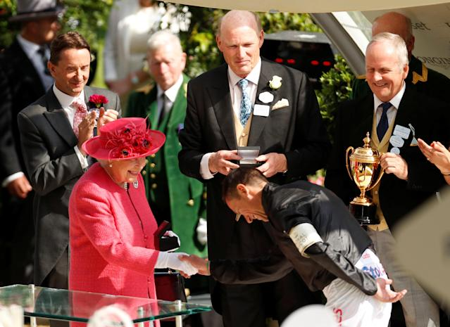 REFILE - CORRECTING TYPO Horse Racing - Royal Ascot - Ascot Racecourse, Ascot, Britain - June 21, 2018 Britain's Queen Elizabeth shakes the hand of Frankie Dettori who won the 4.20 Gold Cup riding Stradivarius Action Images via Reuters/Andrew Boyers