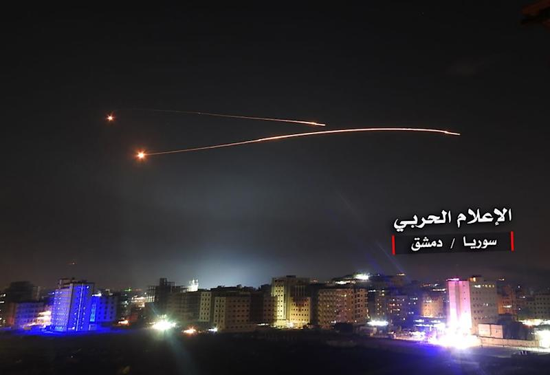 "An image released on May 10, 2018 by the government-affiliated ""Central War Media"" in Syria purportedly shows Syrian air defence systems intercepting Israeli missiles over Damascus' airspace"