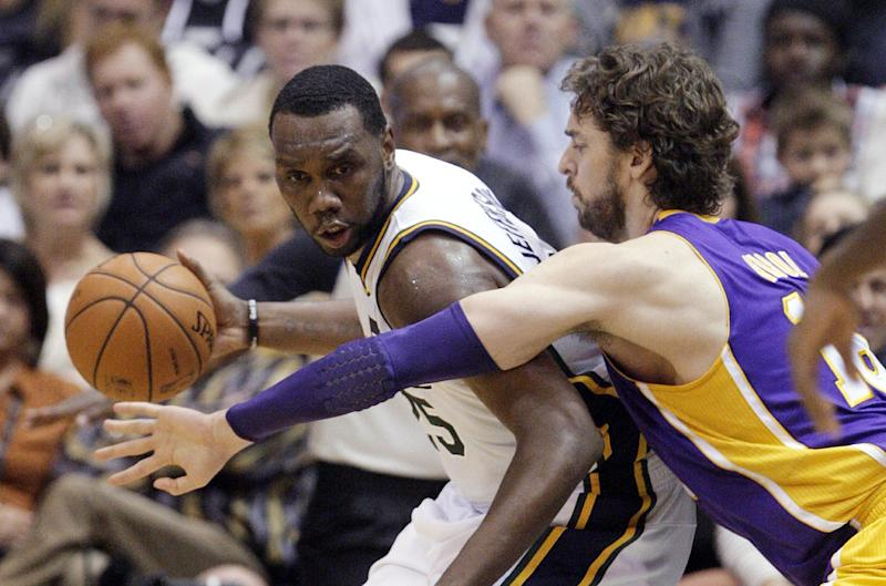 Los Angeles Lakers forward Pau Gasol (16) defends Utah Jazz center Al Jefferson (25) during the second quarter of an NBA basketball game Wednesday, Nov. 7, 2012, in Salt Lake City. (AP Photo/Rick Bowmer)