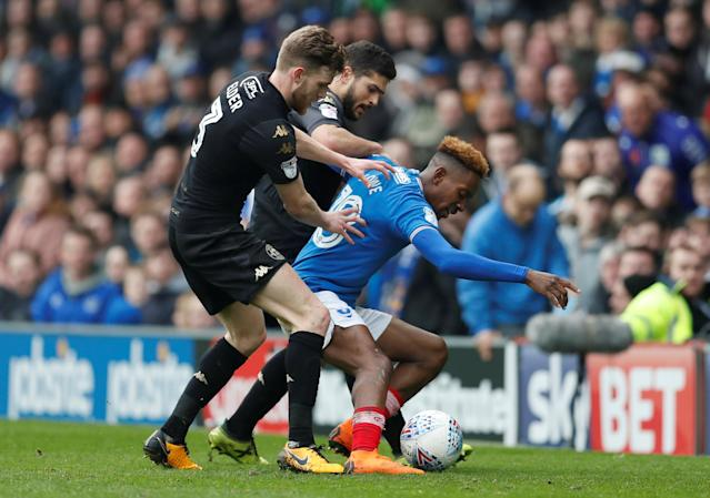 "Soccer Football - League One - Portsmouth vs Wigan Athletic - Fratton Park, Portsmouth, Britain - April 2, 2018 Portsmouth's Jamal Lowe in action with Wigan's Callum Elder Action Images/Matthew Childs EDITORIAL USE ONLY. No use with unauthorized audio, video, data, fixture lists, club/league logos or ""live"" services. Online in-match use limited to 75 images, no video emulation. No use in betting, games or single club/league/player publications. Please contact your account representative for further details."