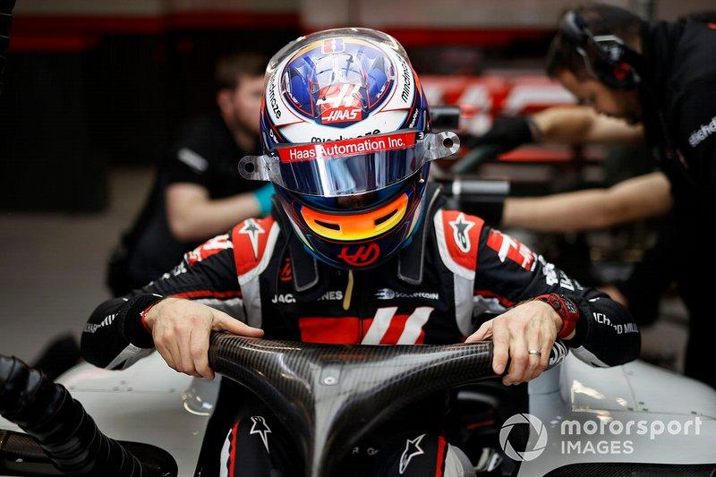 """Romain Grosjean climbs into his Haas VF-20 <span class=""""copyright"""">Andy Hone / Motorsport Images</span>"""