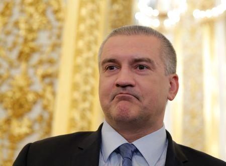 Head of Crimea Aksyonov waits before annual state of nation address attended by Russian President Putin at Kremlin in Moscow