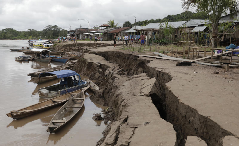 The banks of the Huallaga River are cracked after an earthquake in Puerto Santa Gema, on the outskirts of Yurimaguas, Peru, Sunday, May 26, 2019. A powerful magnitude 8.0 earthquake struck this remote part of the Amazon jungle in Peru early Sunday, collapsing buildings and knocking out power to some areas. (Guadalupe Pardo/Pool photo via AP)