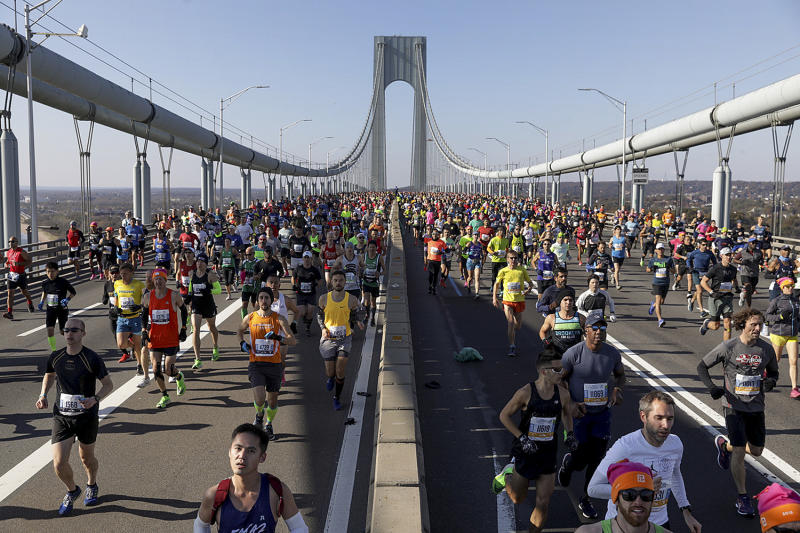 Runners make their way across the Verrazzano-Narrows Bridge during the start of the New York City Marathon, Nov. 3, 2019, in New York. (Photo: Julius Motal/AP)