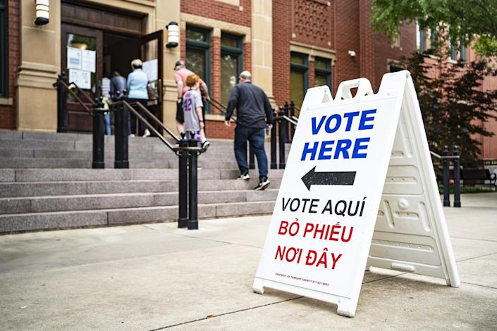 IMAGE: People walk into Southlake Town Hall to vote in municipal elections in Southlake, Texas, on May 1, 2021. (Nitashia Johnson / for NBC News)
